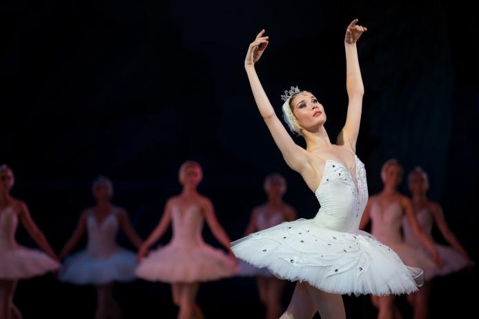 45500412 - prima ballerina white swan on stage dancing gracefully against other dancers. ballet swan lake, the opera house in kiev, ukraine.